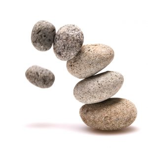 collapsed balanced stones. failure concept.Related image: